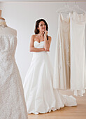 Mixed race woman trying on wedding dresses, Jersey City, NJ