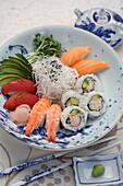 Variety of sushi rolls and sashimi in bowl, Santa Fe, New Mexico, United States