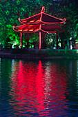 Colorful Vietnamese pagoda near water, Hanoi, Vietnam