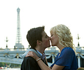 Caucasian man kissing girlfriend near Eiffel Tower, Paris, Paris, France