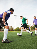 Men playing soccer on soccer field, Ladera Ranch, California, USA