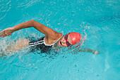 Hispanic woman swimming in swimming pool, Caracas, Caracas, Venezuela