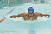 Hispanic man swimming in swimming pool, Caracas, Caracas, Venezuela