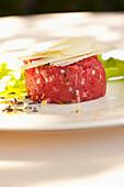 Parmesan cheese atop steak tartare, Alba, Cuneo, Italy