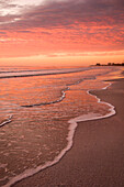 Sunset over tranquil beach, Fort Myers Beach, Florida, United States