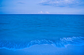 Waves on beach of tranquil blue ocean, Miami Beach, Florida, United States