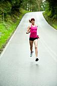 Mixed race woman running on remote road, Bainbridge Island, WA, United States
