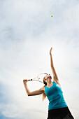 Caucasian woman playing tennis, Orem, Utah, United States