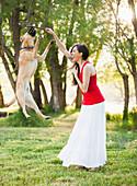Caucasian woman playing with dog, Lehi, Utah, United States