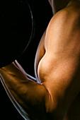 Caucasian man exercising with barbells, Saint Louis, Missouri, United States