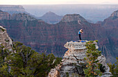 Caucasian woman practicing yoga on top of rock formation, Grand Canyon, Arizona, United States
