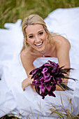Hispanic bride holding bouquet of flowers, Paso Robles, California, USA