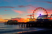 Amusement park on waterfront at night, Santa Monica, California, United States