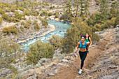 Hispanic runners training in remote area, Questa, New Mexico, USA