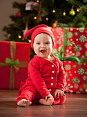 Caucasian baby boy sitting near Christmas tree, Lehi, Utah, USA