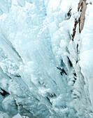 Caucasian man climbing ice, Ouray, Colorado, USA
