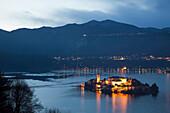 Illuminated island in Italian lake, Orta San Giulio, Novara, Italy