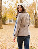 Caucasian woman walking in autumn leaves, Alpine, Utah, USA