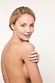 Nude Caucasian woman looking over shoulder, Tilburg, North-Brabant, Netherlands