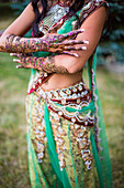 Woman wearing traditional Indian henna and robes, Chicago, Illinois, USA
