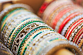 Close up of rows of bangles for sale, Chicago, Illinois, USA