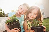 Caucasian girls gardening together, Lehi, Utah, United States