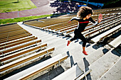 Mixed race runner training in stadium, Los Angeles, California, USA
