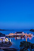 Illuminated building on water at dawn, Bay of Islands, Paihia, new zeland