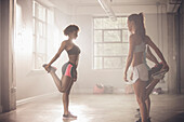 Women stretching in gym, Saint Louis, Missouri, USA