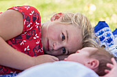 Caucasian girl laying with newborn baby brother, Santa Fe, New Mexico, USA