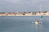 Man and woman in a dinghy, Rovinj, Istria, Croatia