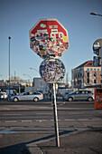 Sticker-plastered Stop sign, East Side Gallery, Berlin, Germany