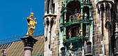 St. Mary's column, Mariensaeule on Marienplatz square with town hall chimes, Munich, Upper Bavaria, Bavaria, Germany