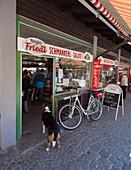 Dog in front of a butchers shop, Viktualienmarkt, Munich, Upper Bavaria, Bavaria, Germany