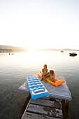 Couple on a pier, Vourvourou, Sithonia, Chalkidiki, Greece