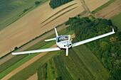 Small sport European LSA Aerospool Dynamic Turbo plane flying over France