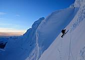 Mountaineer in the north face of Monte Sarmiento, Cordillera Darwin, Tierra del Fuego, Chile