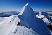 Mountaineer on the ridge between the two summits of Monte Sarmiento, Cordillera Darwin, Tierra del Fuego, Chile