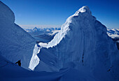 Mountaineer on the ridge between the two summits of Monte Sarmiento, Cordillera Darwin, Tierra del Fuego, Chile