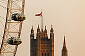 Victoria Tower of the Houses of Parliament aka Westminster Palace and The BA Eye, London, England, United Kingdom