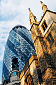 St. Andrew Undershaft and The Gherkin Building, City, London, England, United Kingdom