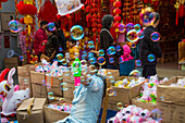 Man with soap bubble toy at a street market near the old town, Nanshi, Shanghai, China