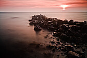 Stones in the morning light, Buelk, Strande, Kiel Fjord, Schleswig-Holstein, Germany