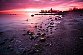 Stones and Buelk lighthouse in the morning light, Strande, Kiel Fjord, Schleswig-Holstein, Germany
