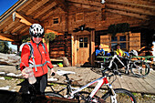 Mountain bikers resting at mountain lodge Kuehrointhuette, Watzmann, Berchtesgadener Land, Upper Bavaria, Germany