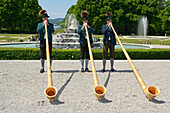 Traditional Bavarian alphorn blowers, Schloss Herrenchiemsee, Chiemsee, Chiemgau, Upper Bavaria, Germany