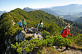 Women hiking along a ridge, Reit im Winkl, Chiemgau, Bavaria, Germany
