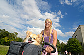 Female cyclist with Chihuahua in a basket, Munich, Upper Bavaria, Germany