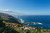 view from El Sauzal to Teide, 3718m, with snow, the island´s landmark, highest point in Spain, volcanic mountain, coastline, Atlantic ocean, Tenerife, Canary Islands, Spain, Europe