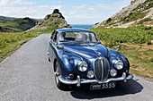 Jaguar Oldtimer on its way from Valley of the Rocks near Lynton, Devon, England, Great Britain